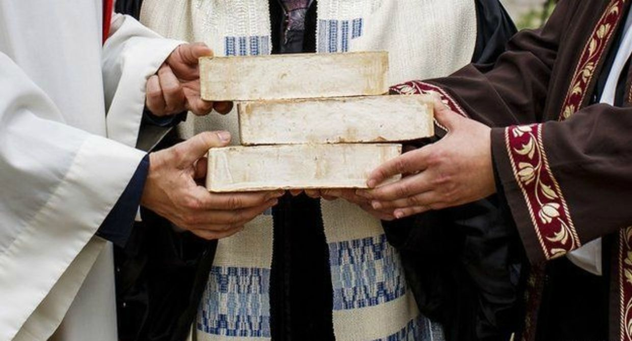 Pastor, Rabbi and Iman hold bricks for House of One