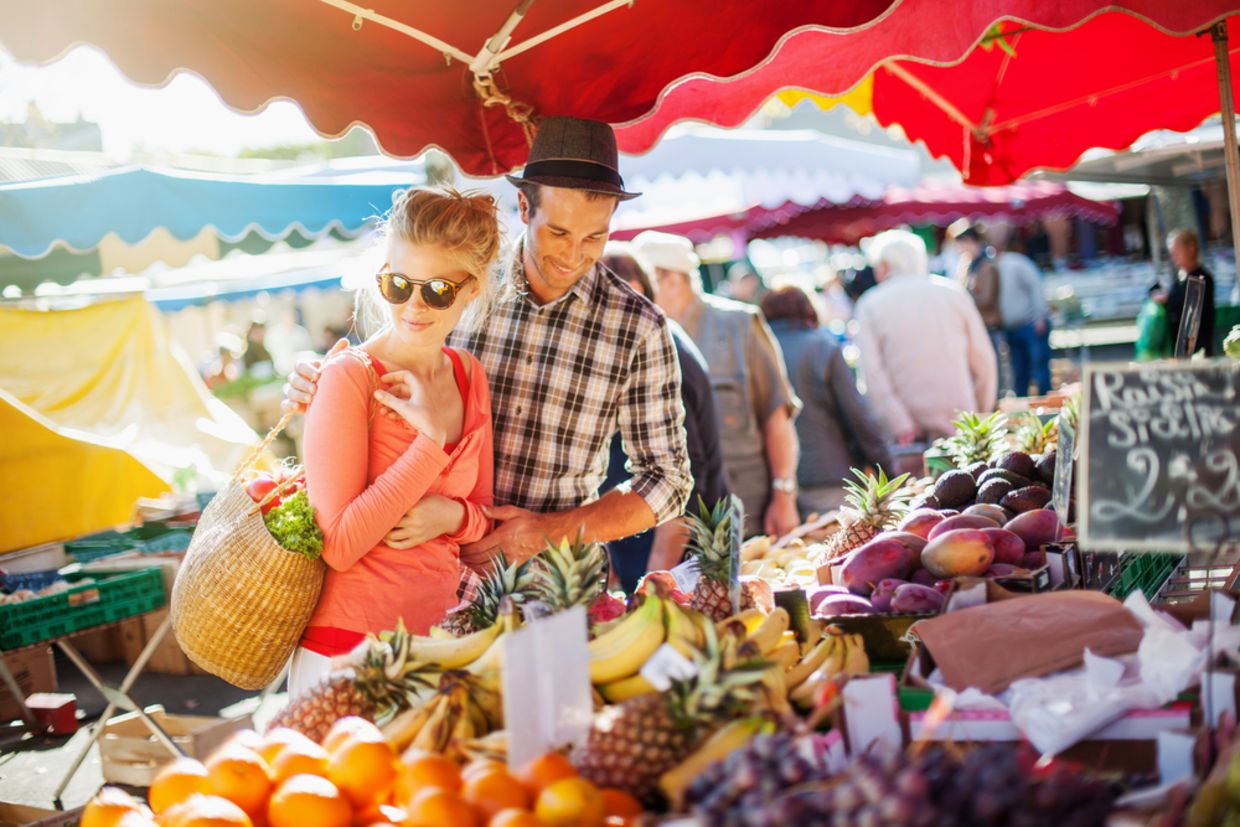 Couple looking at fruits in farmer's market