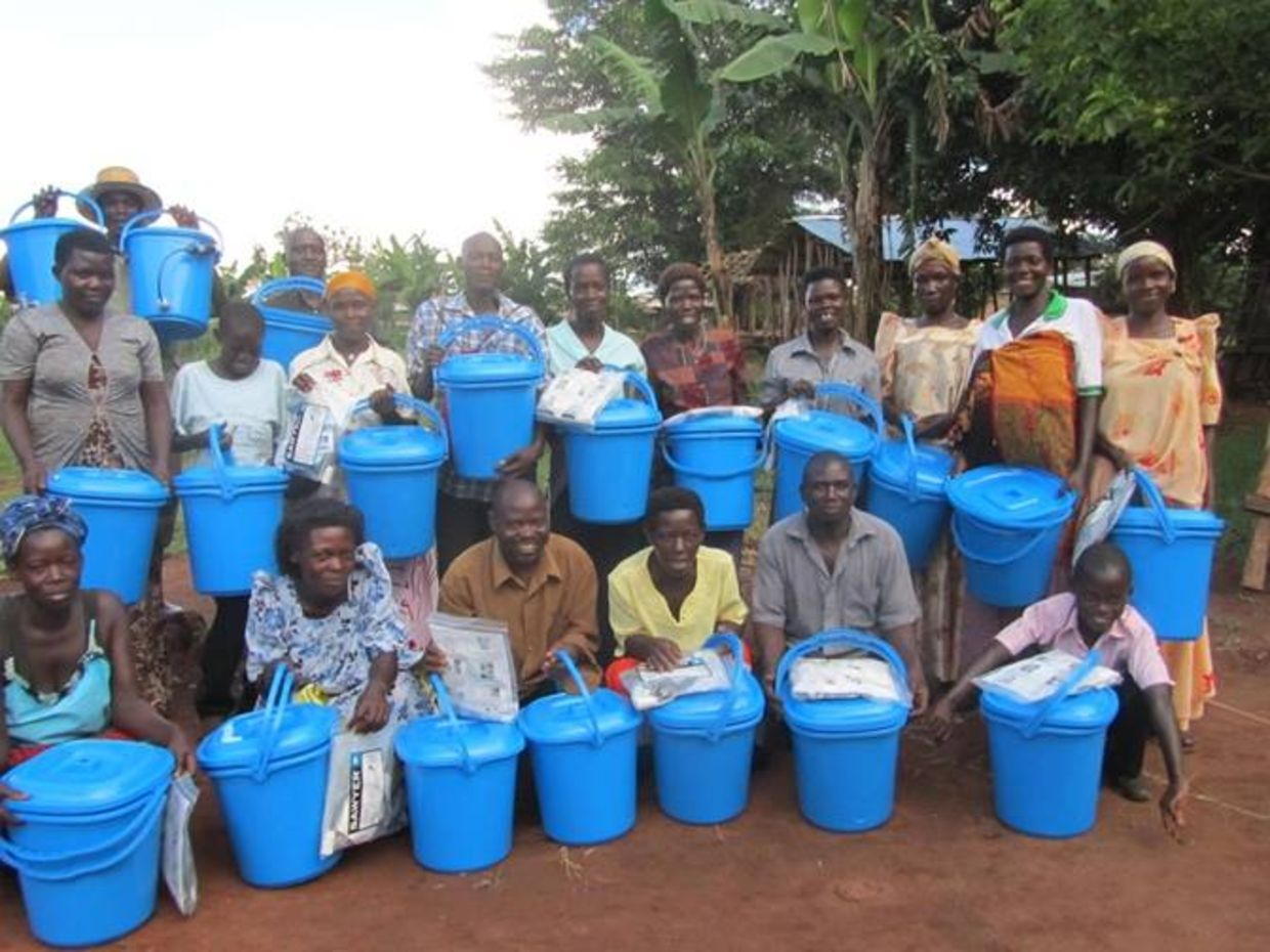 Ugandans holding water filtration packets