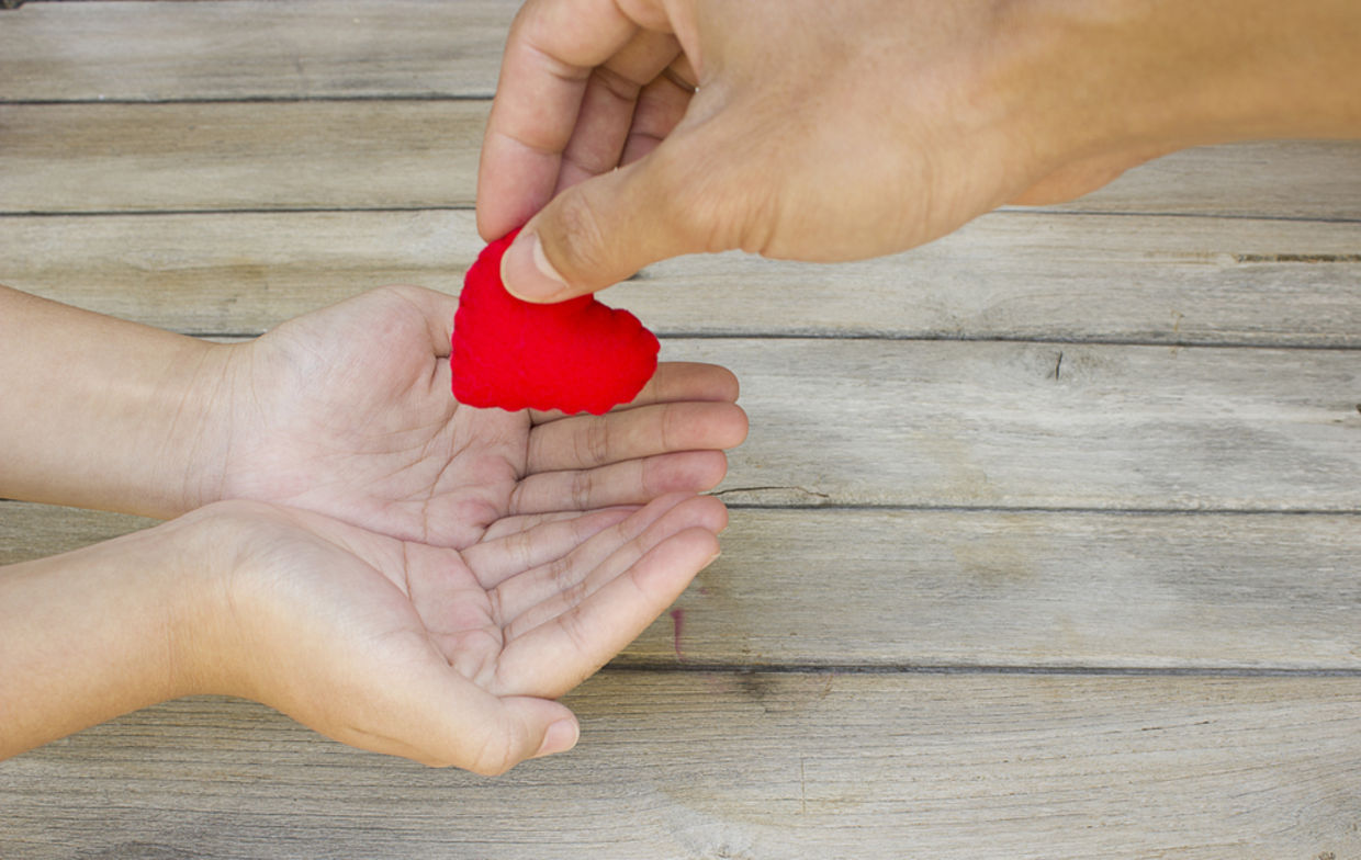 scientific facts about the benefit of doing good goodnet hand handing over a heart