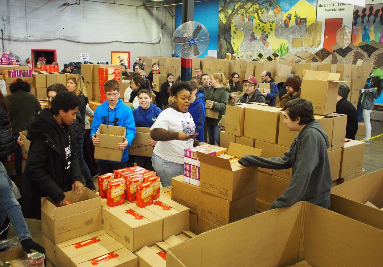 Volunteers for the Jewish Relief Agency package goods to be distributed to those in need. (Jewish Relief Agency)