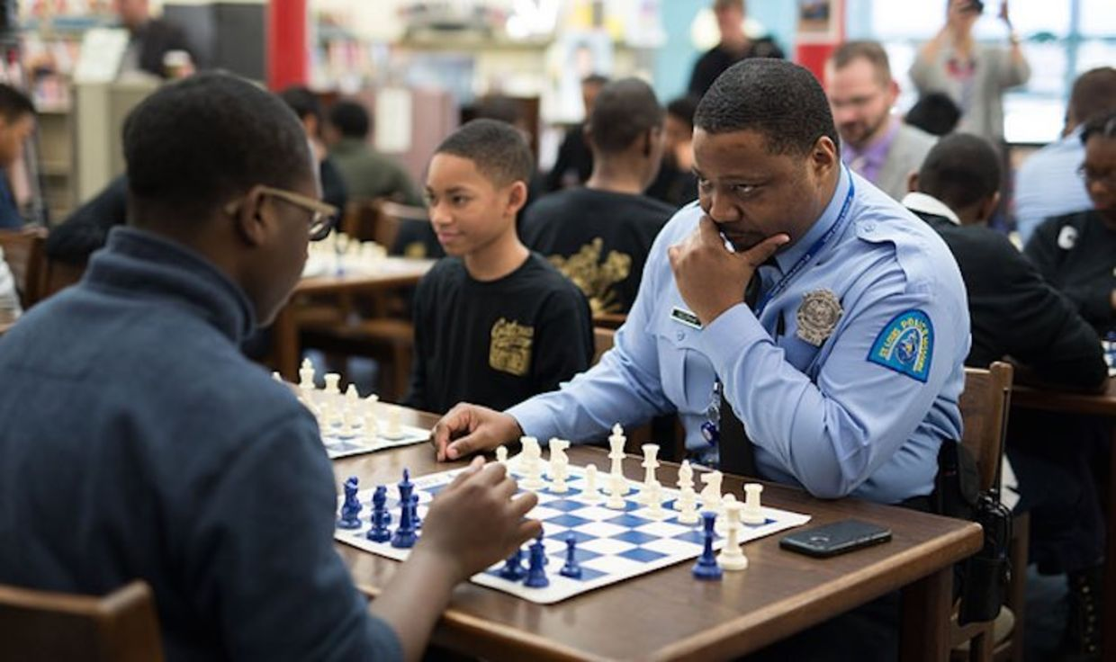 Nine officers educate inner city kids on critical thinking skills, planning, and logic. (Austin Fuller, CCSCSL)