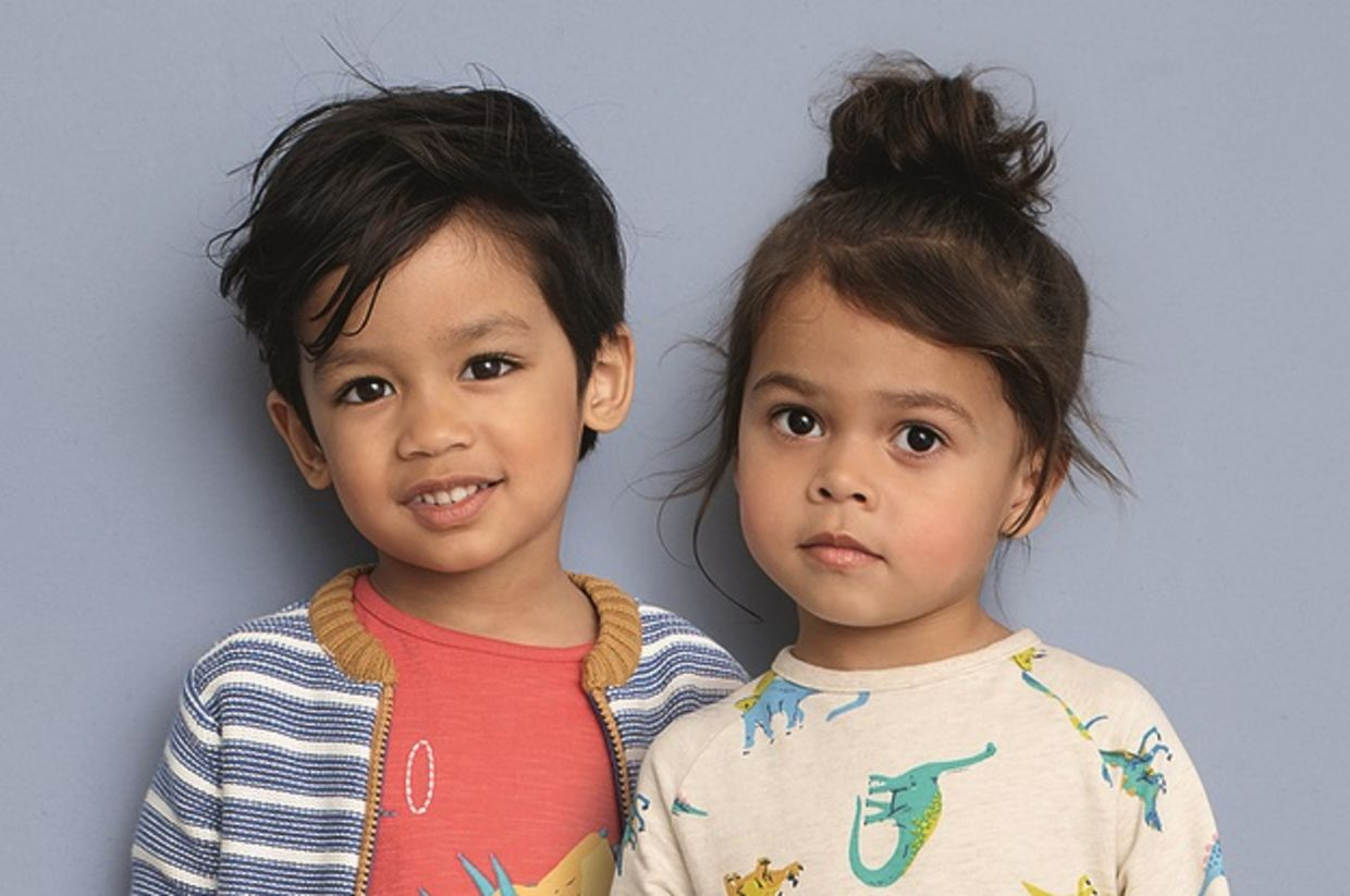 Two child models show off clothes from John Lewis' new gender neutral collection