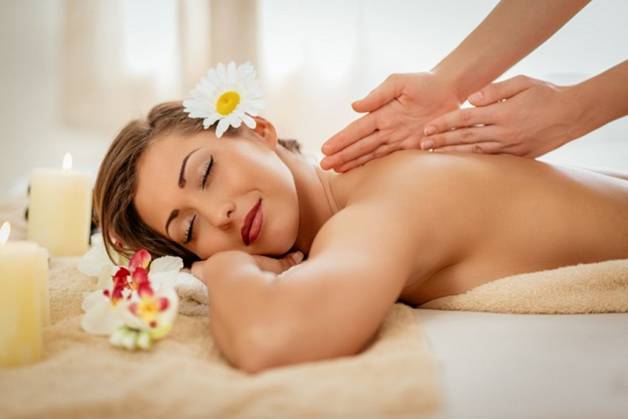 Woman enjoying during a back massage at a spa.