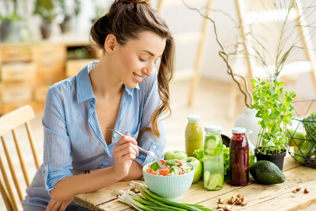Young woman eating a healthy salad