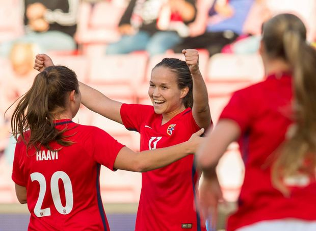 Female players from Norway's national team celebrate after a 4-1 victory over Northern Ireland