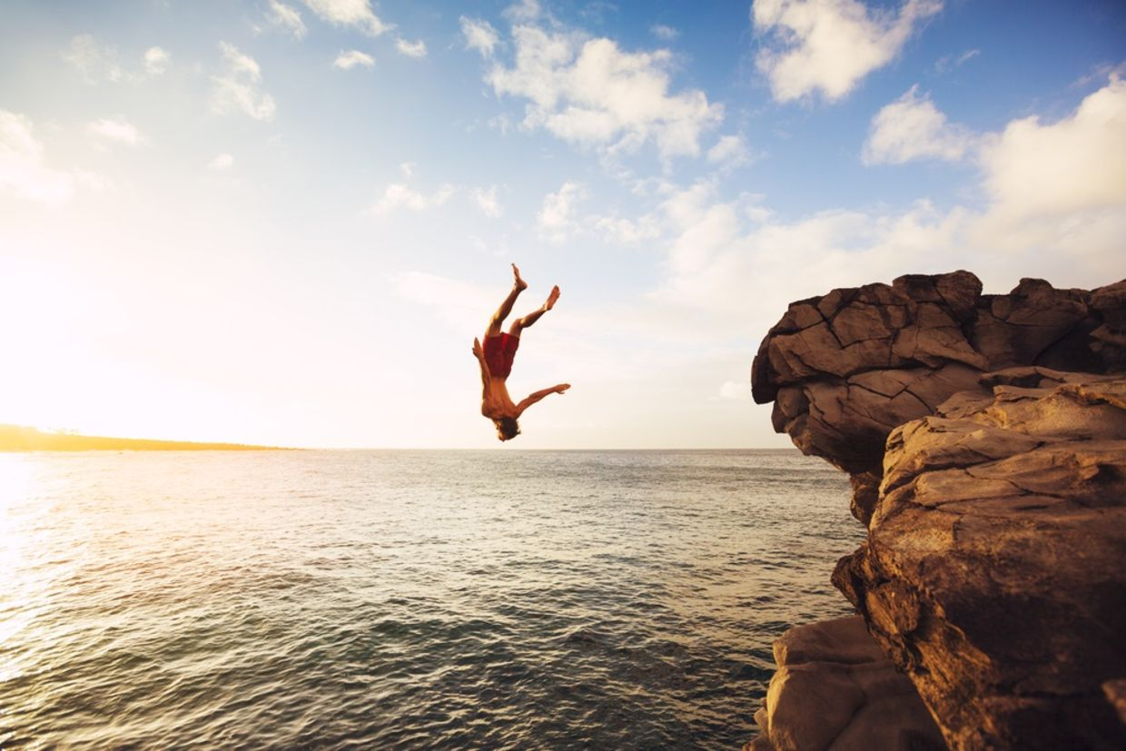 Cliff Jumping into the Ocean at Sunset