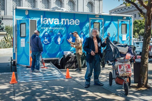 People living on the street come to the Lava Mae bus to take showers.
