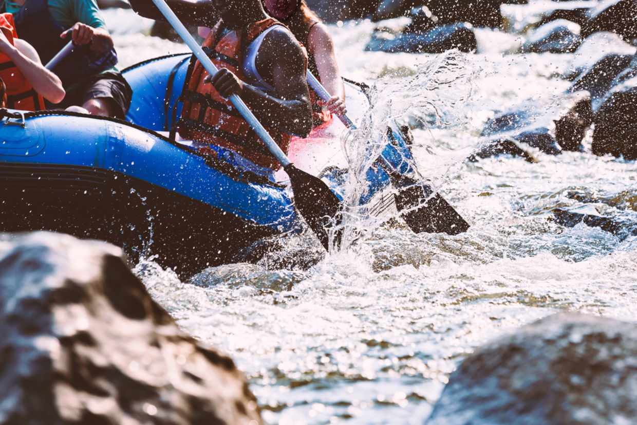 take a risk - Close-up of young person rafting on the river