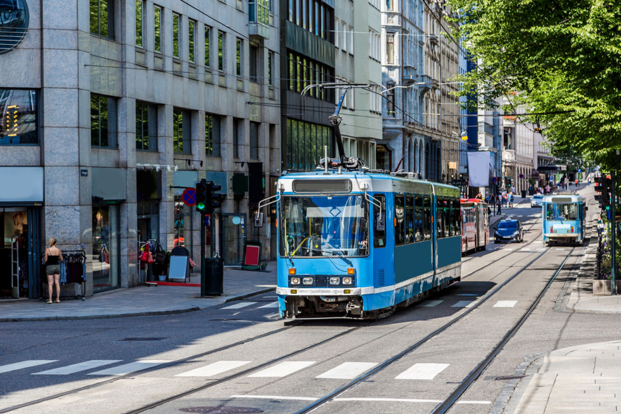 Modern blue tram in Oslo in Norway in a summer day