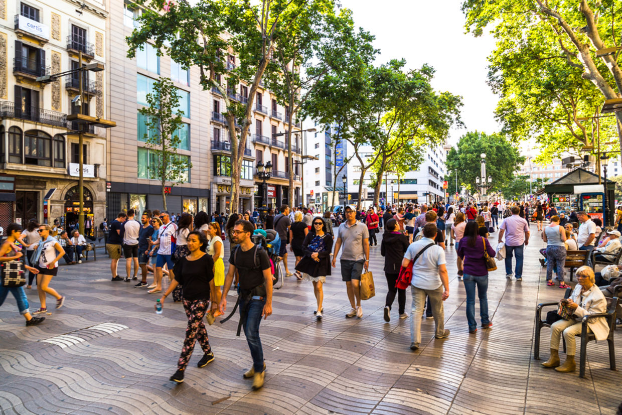 Hundreds of tourists from all over the world visit and stroll the streets of Barcelona
