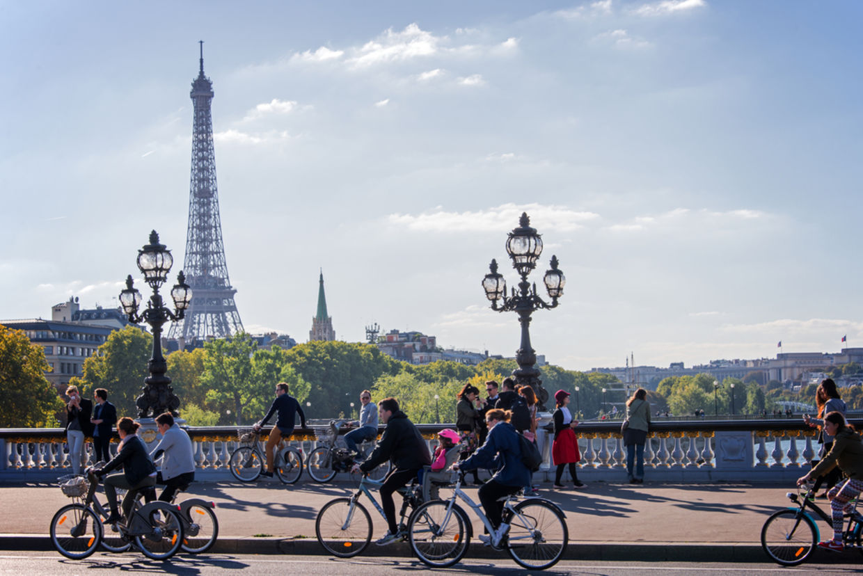 People on bicycles and pedestrians enjoying a car-free day on Alexandre III bridge on September 27, 2015 in Paris, France
