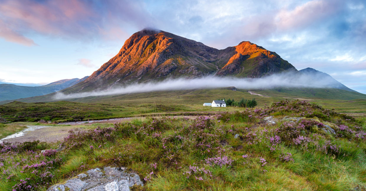Sunrise over the mountain tops at Glencoe in the highlands of Scotland