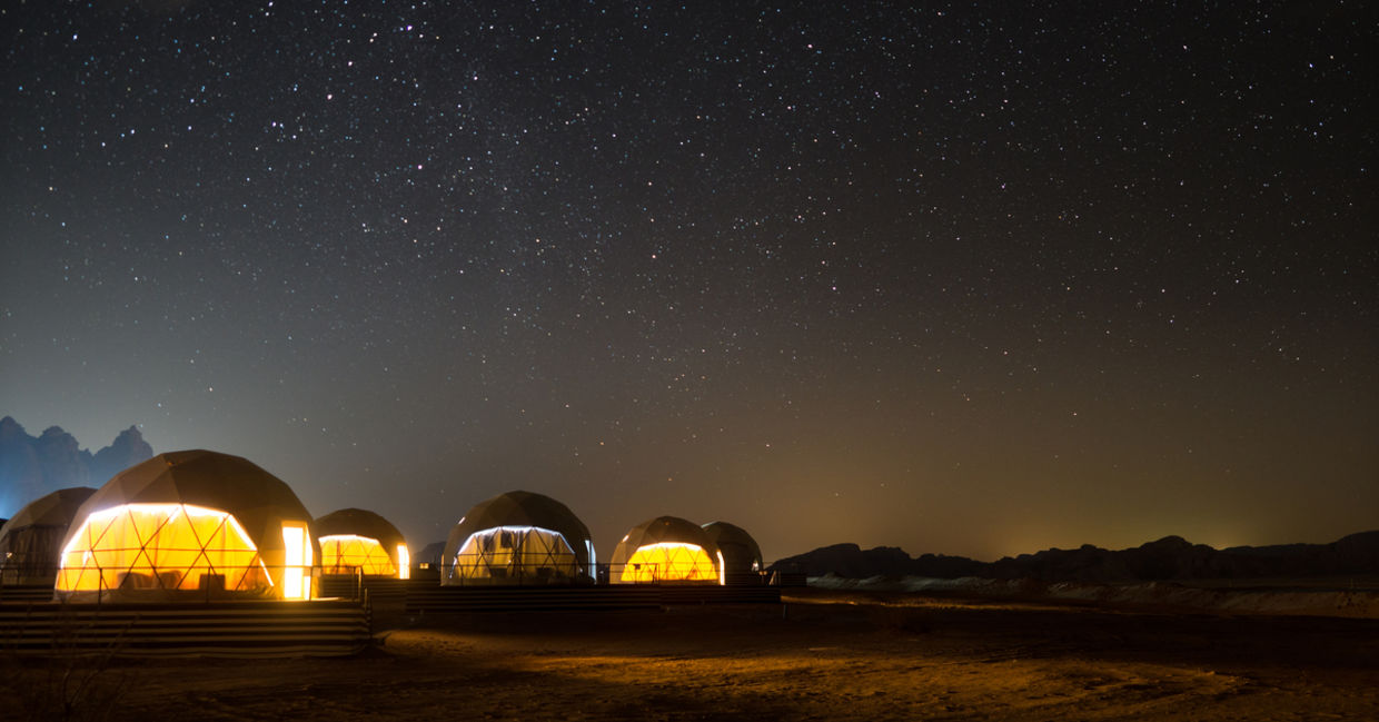 Stars above martian dome tents in Wadi Rum Desert, Jordan
