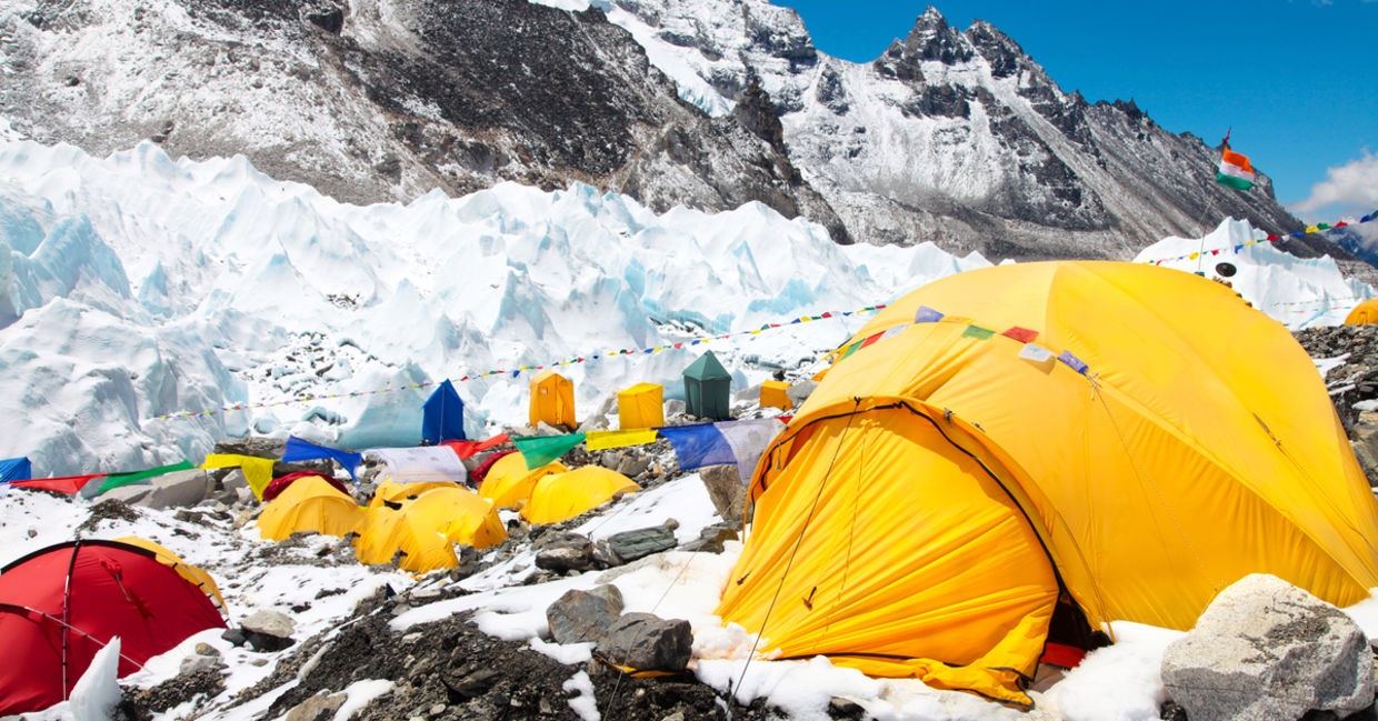 Bright yellow tents in Mount Everest base camp, Khumbu glacier and mountains, sagarmatha national park, trek to Everest base camp