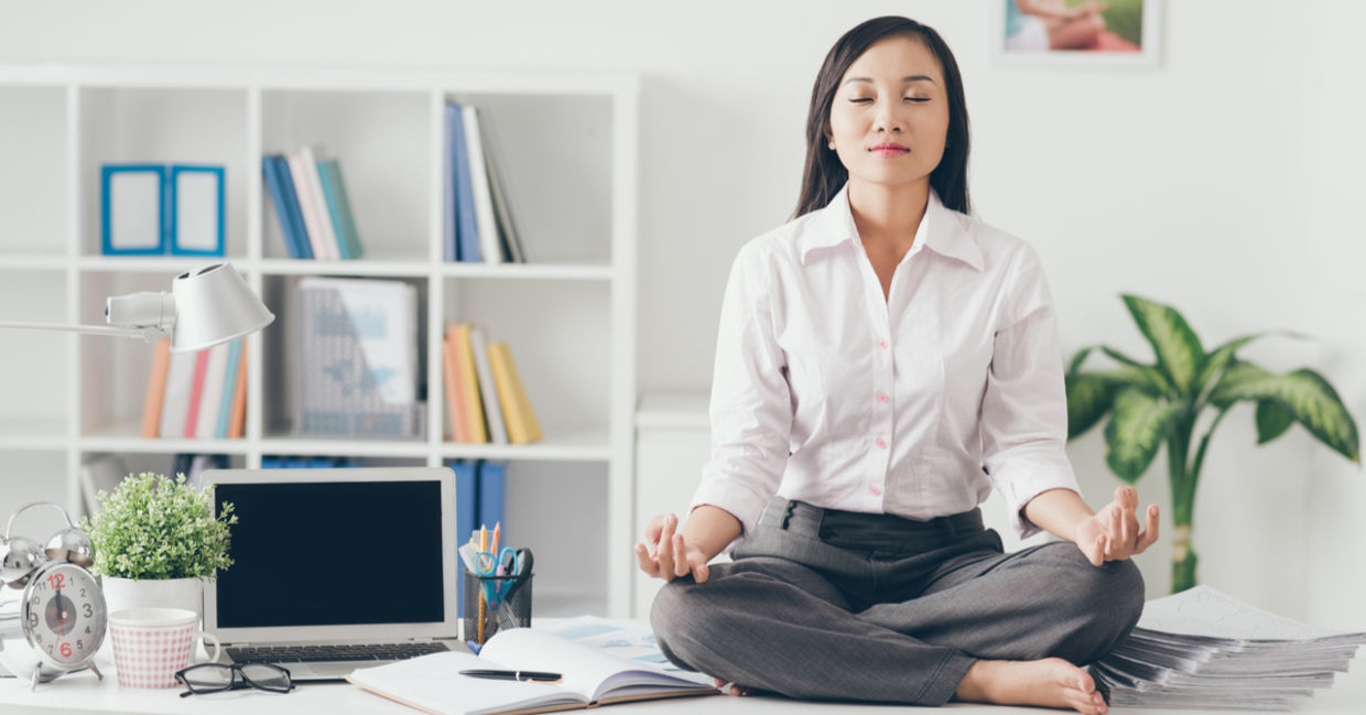 Meditating during your lunch break increases productivity, reduces stress. (Shutterstock)